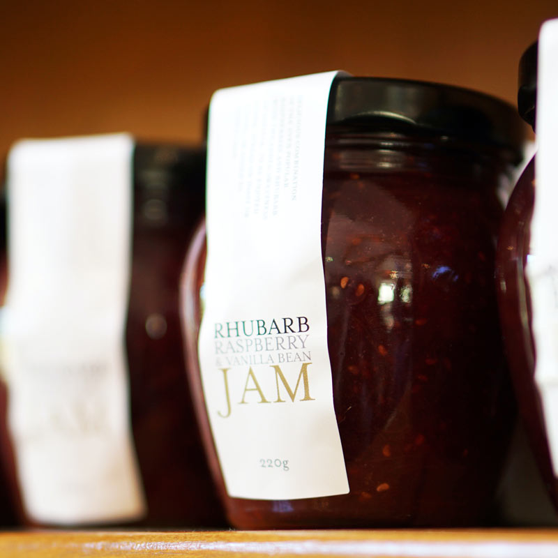 Jar of jam with label on a store shelf